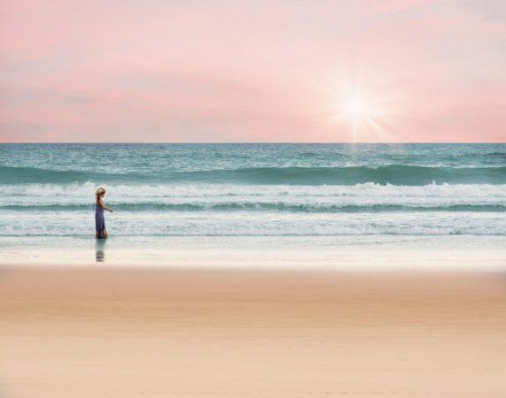 child walking on the beach