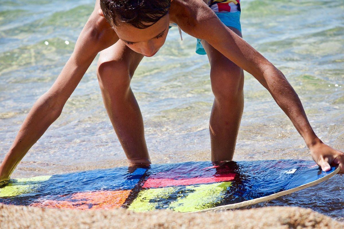 Boy skim-boarding in Anna Maria Island
