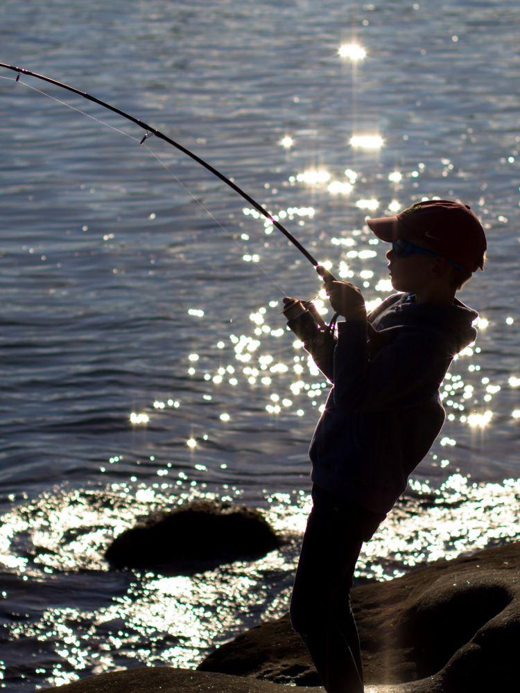 little boy fishing in anna maria island